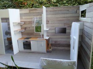 Un intérieur de Tiny house organisé et dont les zones sont bien déterminées.